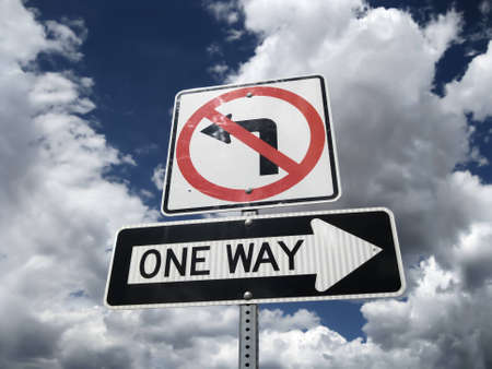 Traffic sign One Way no left turn Stock Photo
