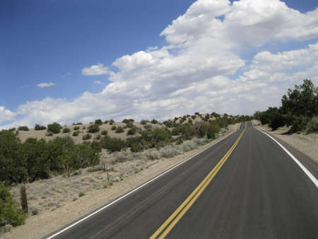 Paved road in the desert in oblique angle photo
