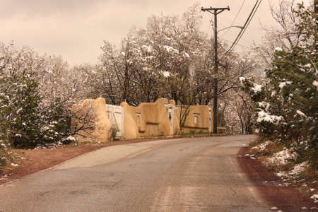 Vintage road and house in winter photo