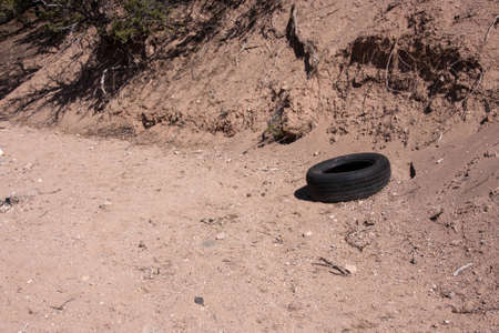 Old tire dumped in nature Stock Photo - 14589139