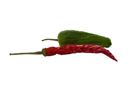 A dried red chile and an almost dried green chile photo