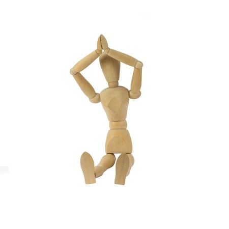 Wooden female figure is doing yoga photo