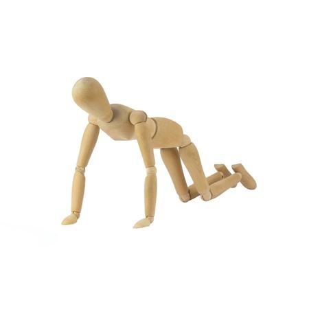 Wooden female figure is doing pushups photo