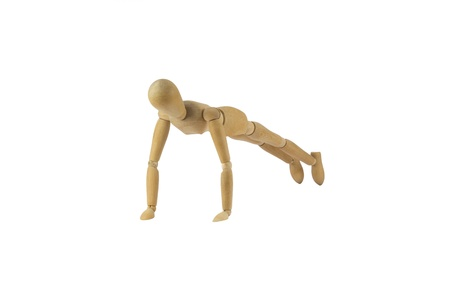 Wooden female figure is doing pushups photo