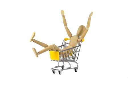 A happy wooden female doll in a shopping cart