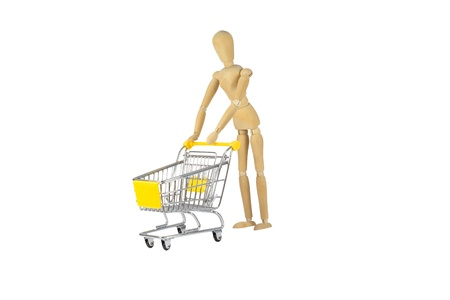 A wooden female doll is pushing a shopping cart photo