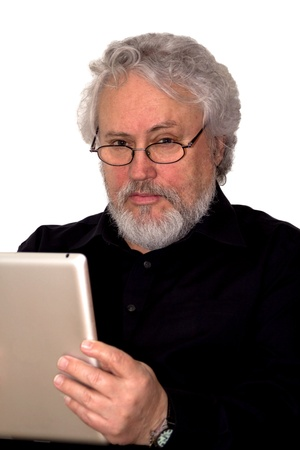 A senior with grey hair is holding a tablet and looking suspicious Stock Photo - 18454723
