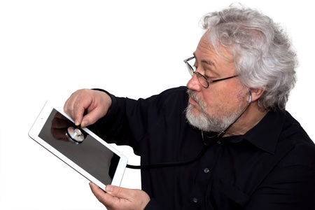A senior is doing a diagnosis on a tablet pc photo