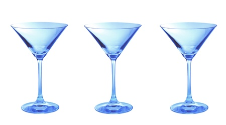 Three blue empty martini glasses in a row isolated photo