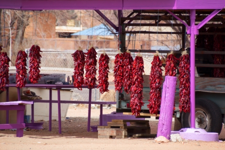 Rural fruit stand with red dried chillies photo