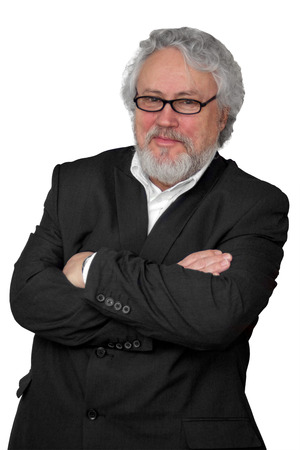 grey haired: Grey haired senior wearing a dark suit and glasses