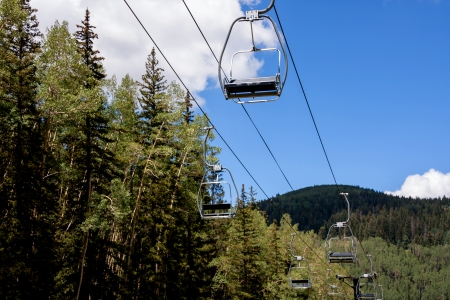 Empty ski lift seats in alpine summer landscape Stock Photo