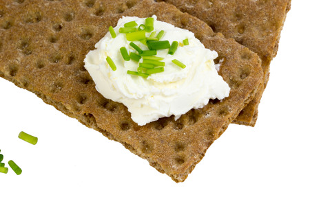 Macro shot of crispbread with cream cheese and chives photo