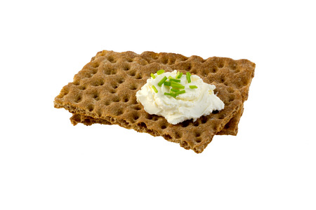 Crispbread with cream cheese and minced chives photo