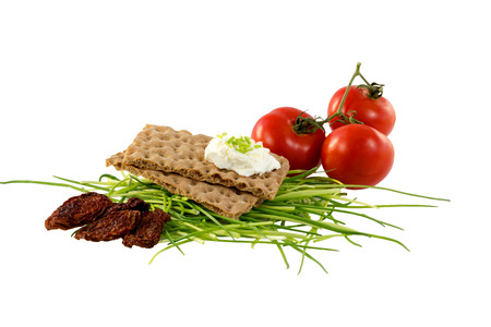 Crispbread with cream cheese, chives and tomatoes photo