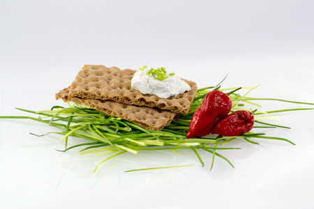 Crispbread with cream cheese chives and chile photo