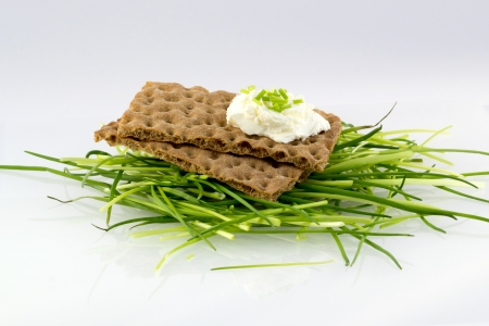 Crispbread with cream cheese and minced chives on top photo