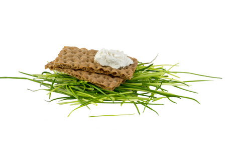Crispbread with cream cheese and herbs photo