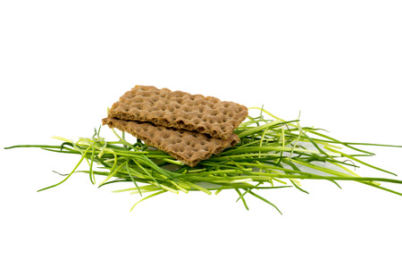 Crispbread on a stack of chives photo