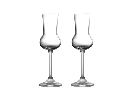 grappa: Two empty Grappa glasses upright position Stock Photo
