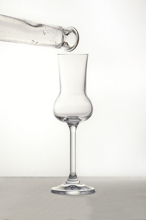 grappa: Pouring the Grappa into a glass Stock Photo