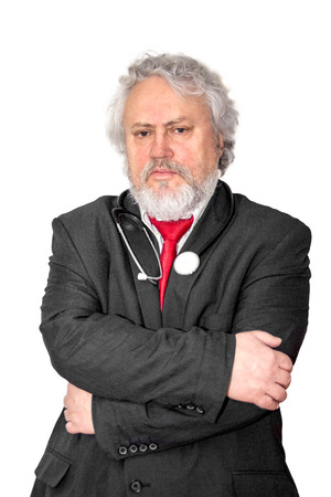 A gray haired and bearded doctor looking concerned photo