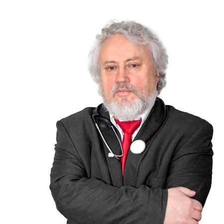 Un medico dai capelli e barba grigia che sembra serio neutro Archivio Fotografico