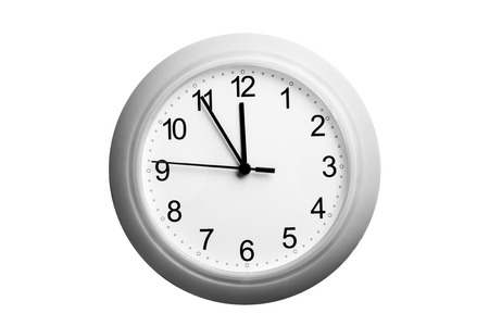five to twelve: A single simple clock showing the time five to twelve