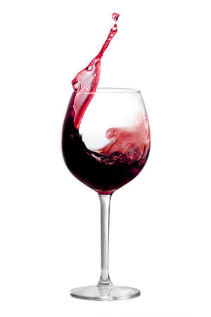 Red wine is splashing out of a wine glass Stockfoto