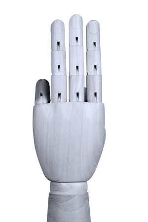 three fingers: Wooden model hand showing three fingers  up with back of the hand be seen