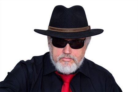 gray haired: Gray haired senior with hat, sunglasses and red necktie looking into camera Stock Photo