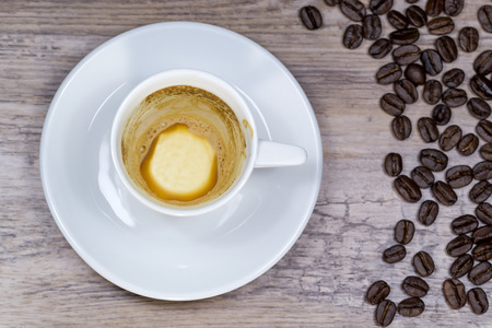 Empty espresso on wooden table with blurred background from above