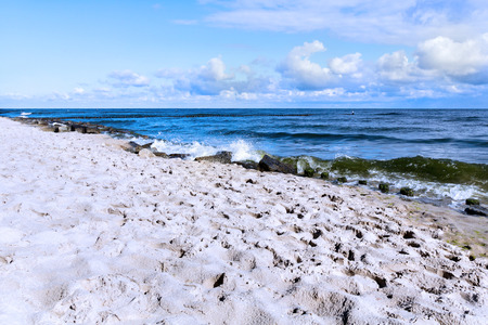 Empty beach in bright morning sunshine at Baltic Sea