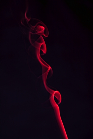 Photo red smoke on the black background
