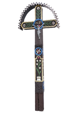 Photo of the old hand-carved and painted wooden crucifix isolated on a white background. This type of cross is typical for the region Detva Slovakia Stock Photo - 18281337