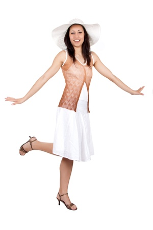 Brunette woman in white sun hat in a white dress, on white background, dancing charleston photo