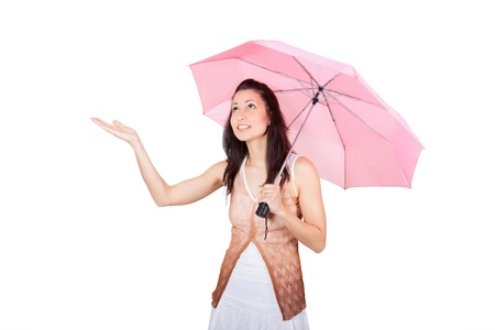 figuring: Brunette woman in a white dress with pink umbrella figuring what the weather is