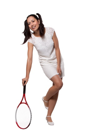 Woman in white dress retro, relies on a tennis racket, isolated on white background Stock Photo - 19984610