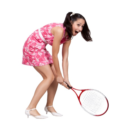 Retro girl in a pink dress, playing with tennis racket isolated on white background