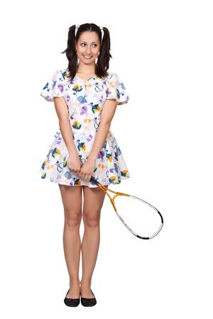Woman in colorful retro dress, holding a squash racket, smiling, isolated on white background