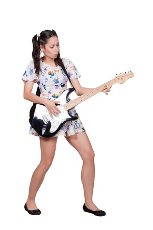 Woman in colorful retro dress, passionately plays the electric guitar, isolated on white background Stock Photo