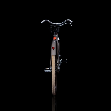 refurbished: Old refurbished retro bike isolated on black background with reflection view from behind