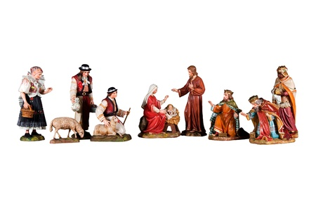 bethlehem crib: Wooden Sculptures nativity scene, depicting the family of God, three kings and the shepherds, isolated on white background Stock Photo