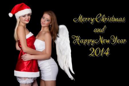 Chicas sexy Santa Claus y Angel est�n celebrando, con las palabras Feliz Navidad y Feliz A�o Nuevo 2014 Foto de archivo - 22565575