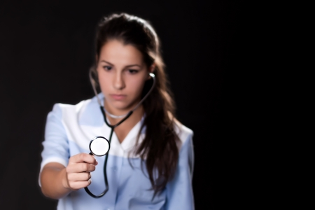 Portrait of woman doctor with blurred face and focus on the stethoscope