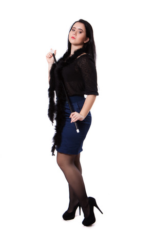 Young woman in retro clothes posing with a stick, on a white background photo