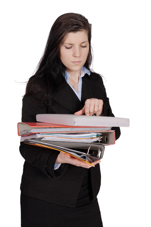 Woman in a jacket holding a pile of documents and reading, isolated on white background