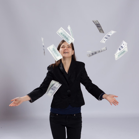Young long-haired woman throws dollars up to photo