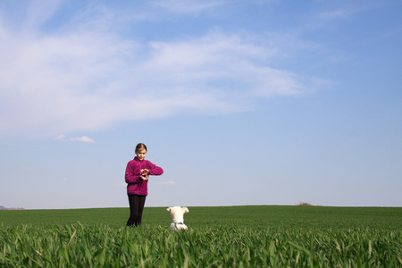 Girl playing with her dog on the grass Stock Photo - 26932775