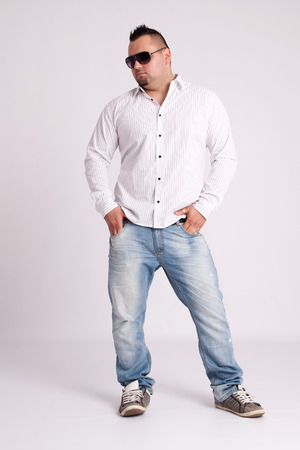 Young businessman in white shirt standing and thinking photo